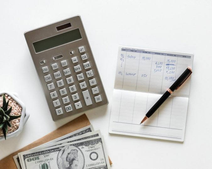 calculator-calculating-expenses-675x539 5 Important Considerations to Make Before Buying Your Wedding Dress