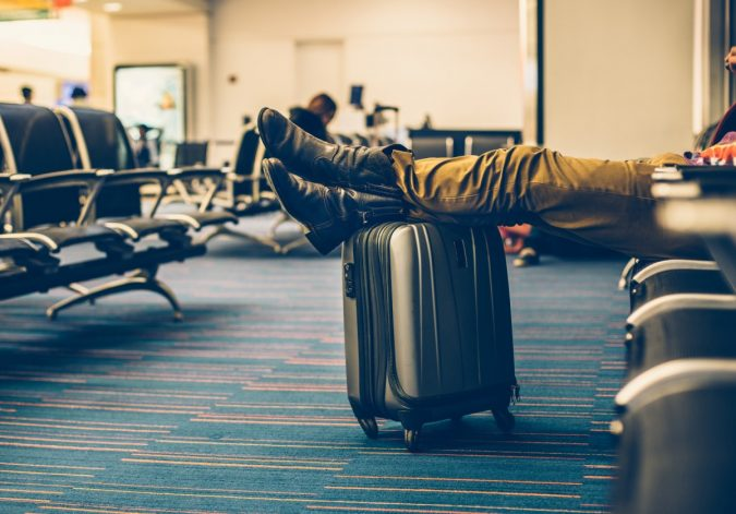 delayed-flight-waiting-675x471 5 Travel Tips to Help You Save (Or Gain) Money on Your Next Trip