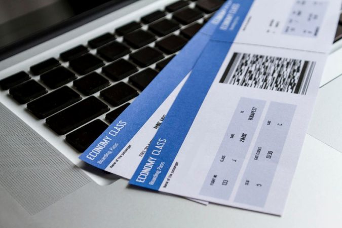 laptop-flight-tickets-675x450 5 Travel Tips to Help You Save (Or Gain) Money on Your Next Trip