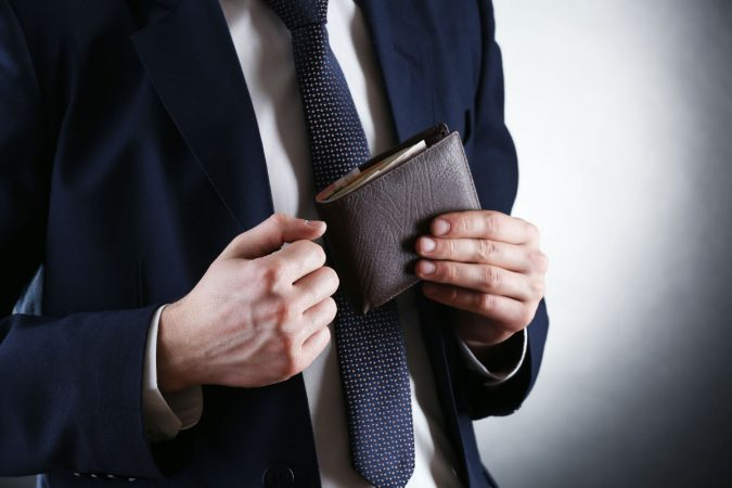 men-accessories-man-holding-wallet-675x450 10 Accessories Every Man Should Own