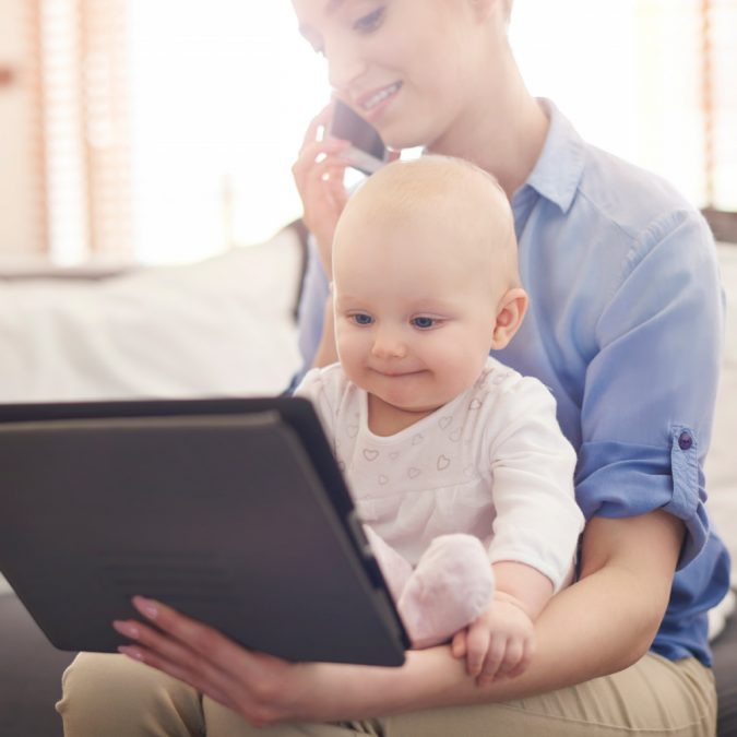 tablet-woman-working-and-holding-child-675x675 Rare Genetic Disorder: 5 Ways to Show a Family Emotional Support