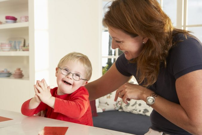 woman-and-child-Downs-Syndrome-boy-having-speech-therapy-675x450 Rare Genetic Disorder: 5 Ways to Show a Family Emotional Support