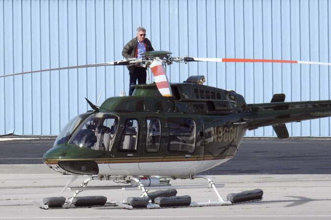 Harrison-Ford-Stands-on-Helicopter-675x450 15 Most Luxurious Helicopters and Private Jets Owned by Celebrities!