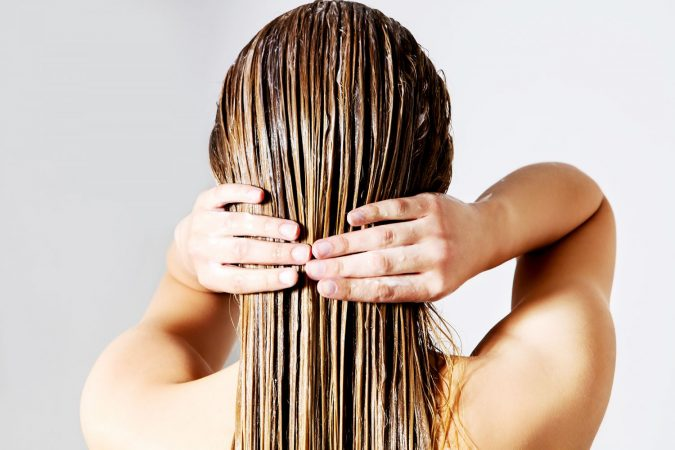 applying-hair-conditioner-675x450 15 Natural Hair Beauty Tips for All Hair Types