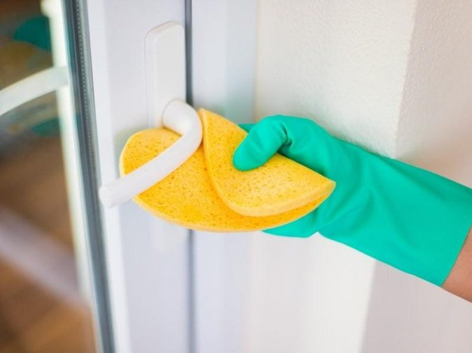 cleaning-door-knobs-675x506 6 Most Essential Things in Your Home to Keep Clean
