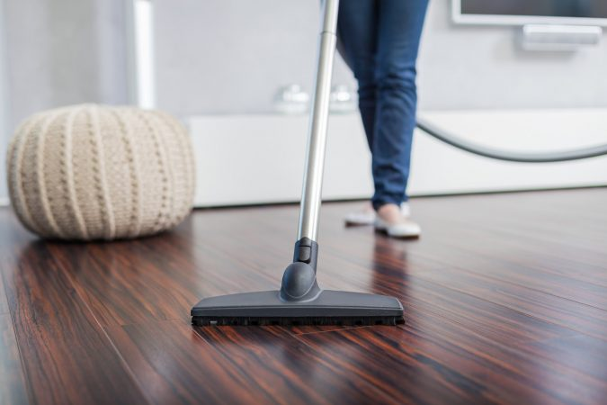 home-cleaning-Vacuum-wooden-floor-675x450 Top 4 Reasons You Might Need a Professional Home Cleaning Service