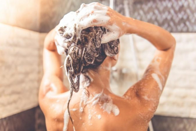 lady-in-a-shower-washing-her-hair-675x450 15 Natural Hair Beauty Tips for All Hair Types