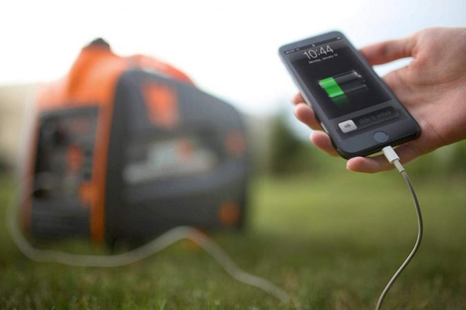 mobile-charging-Inverter-Generator-675x450 Inverter Generators – What Are They and Why Do You Need One?