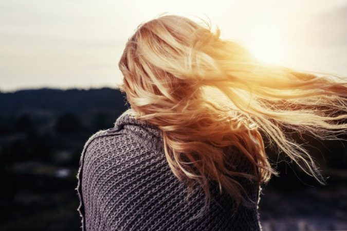woman-enjoying-sunlight-675x449 15 Natural Hair Beauty Tips for All Hair Types