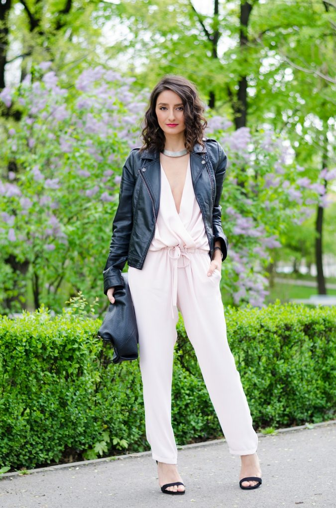 leather-jacket-jumpsuit-outfit-675x1020 20 Must-Have Wardrobe Pieces Every Woman Over 40 Needs