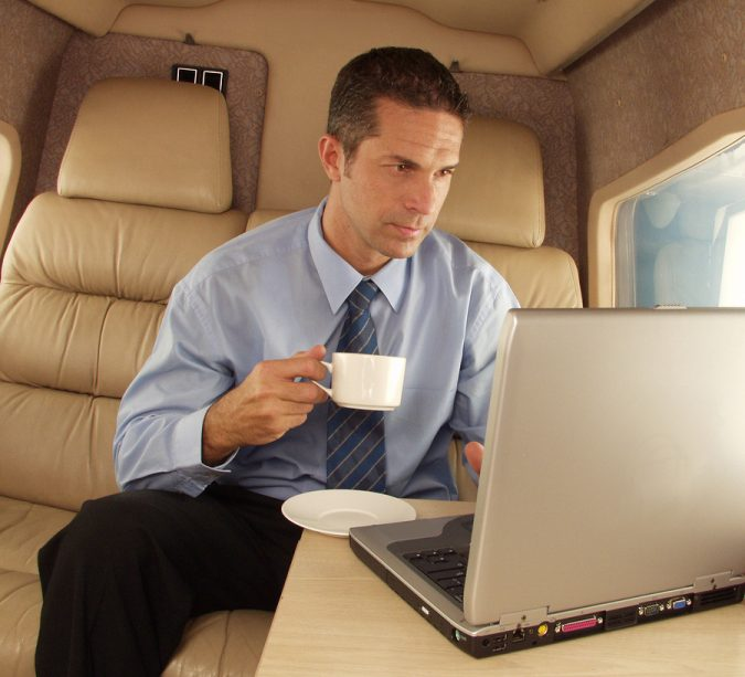 Businessman-working-at-privat-jet-675x613 5 Benefits of Renting a Private Jet