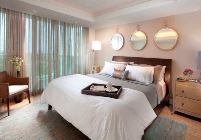 adding-mirrors-in-your-bedroom-675x473 8 Tricks You Can Do Make Your Home Look Great