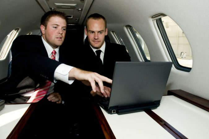 laptop-working-at-private-jet-675x448 5 Benefits of Renting a Private Jet