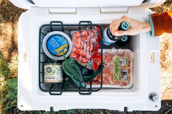 packing-a-cooler-for-camping-675x450 Top Tips on Surviving Your First Family Camping Trip