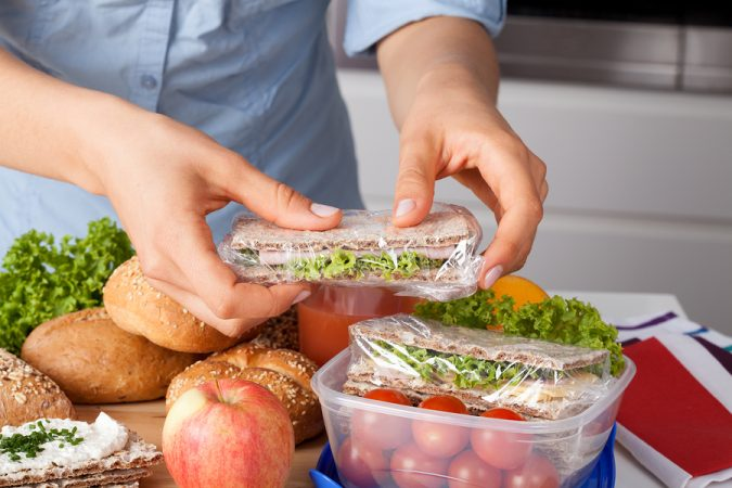 Woman-Preparing-Meal-675x450 6 Ways to Stay Healthy on a Busy Schedule