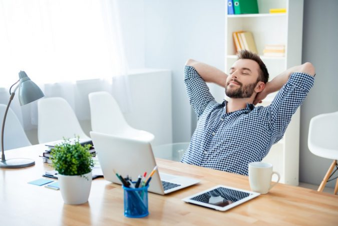 a-man-relaxing-at-his-desk-at-work-1-675x451 6 Ways to Stay Healthy on a Busy Schedule