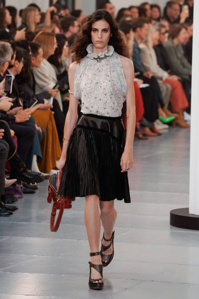 spring-summer-fashion-2020-abstracl-florals-ruffled-top-pleated-skirt-chloe-675x1015 What Women Should Wear for a Business Meeting [60+ Outfit Ideas]