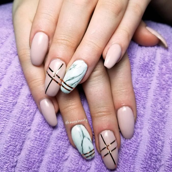 nude-gemstone-nail-art-675x675 Top 10 Most Luxurious Nail Designs for 2020