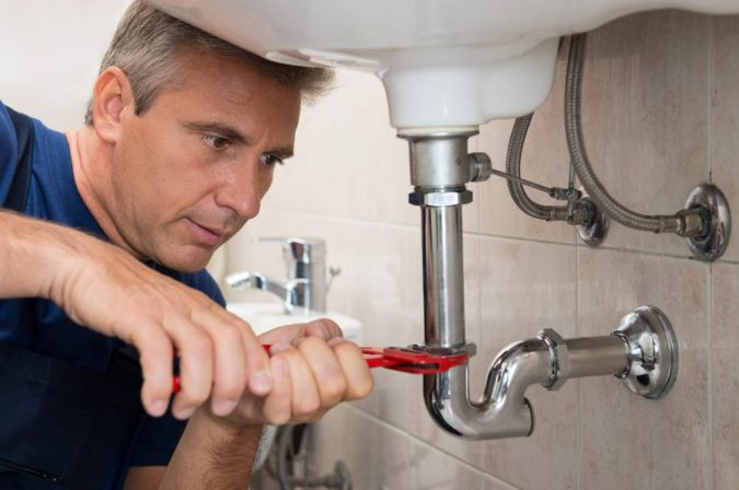 plumber-working-675x448 A Quick Guide on How to Choose the Best Plumber in Your Area