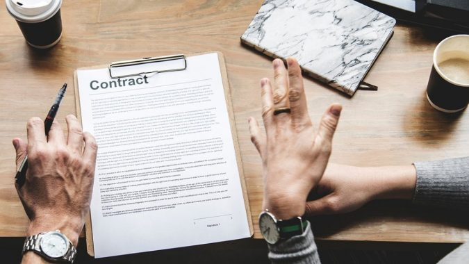 sign-a-contract-675x380 How to Secure an Instagram Brand Partnership in Six Steps