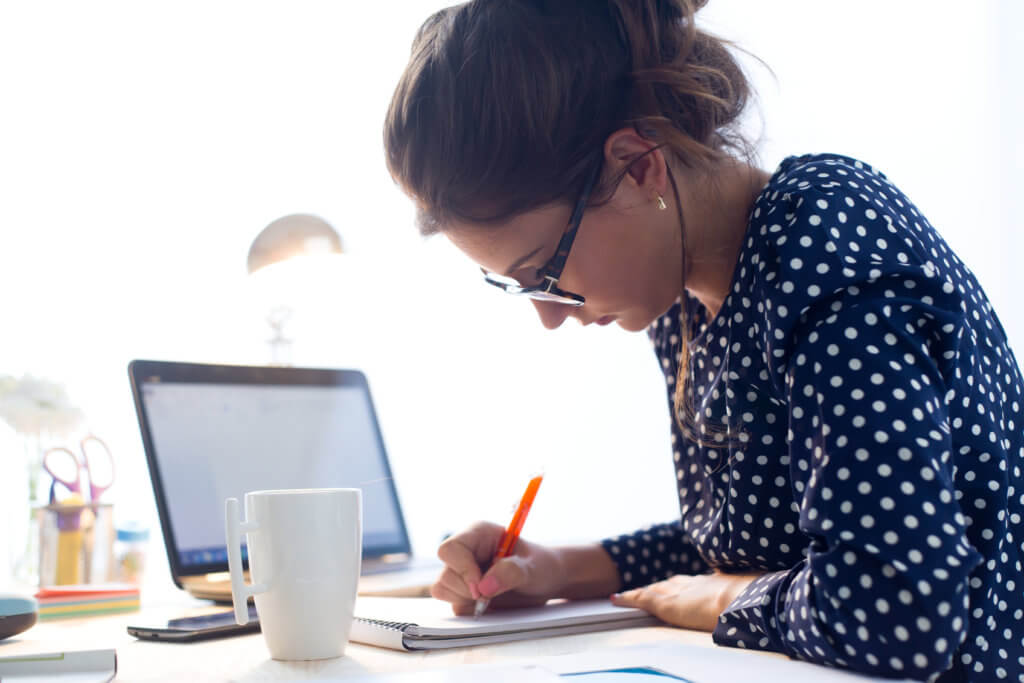 laptop-woman-working 14 Ways to Improve Your Grades if You're Underperforming