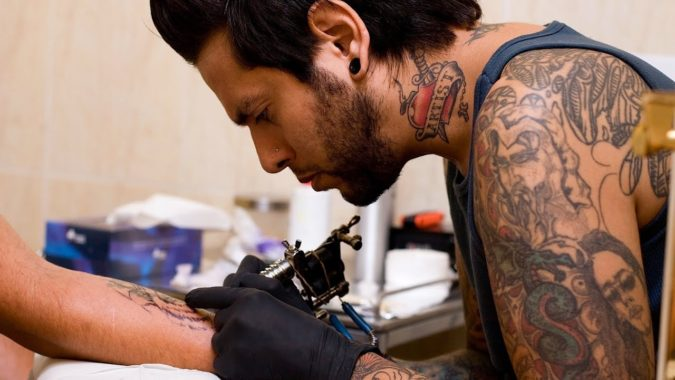tattoo-artist-675x380 What You Need to Know about Scar Cover-Up Tattoos