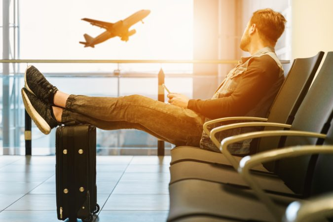 traveler-airplane-675x450 7 Main Factors for Choosing the Best Airline for Your Travel