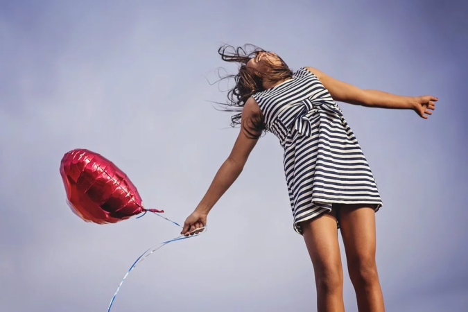girl-holding-balloon-joy-675x450 Healthy Alternatives: Why CBD Oil Is Worth Your Time and Money