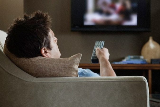 man-rests-and-watch-tv-675x452 How to Get Back to Routine After a Car Accident