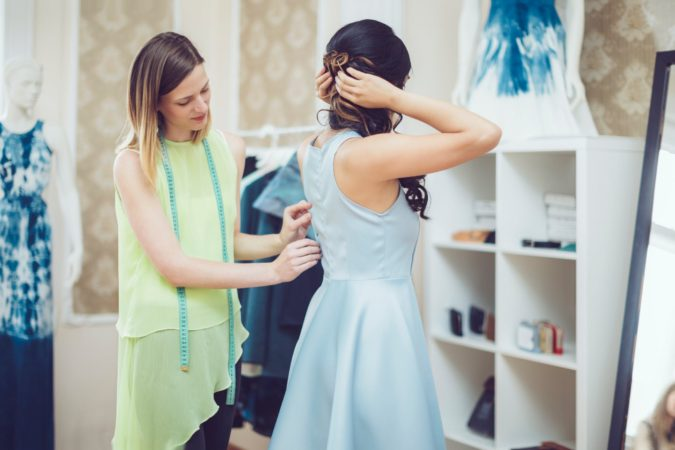 tailoring-a-dress-tailor-675x450 Getting an Outfit Custom Made: 5 Tips for Success