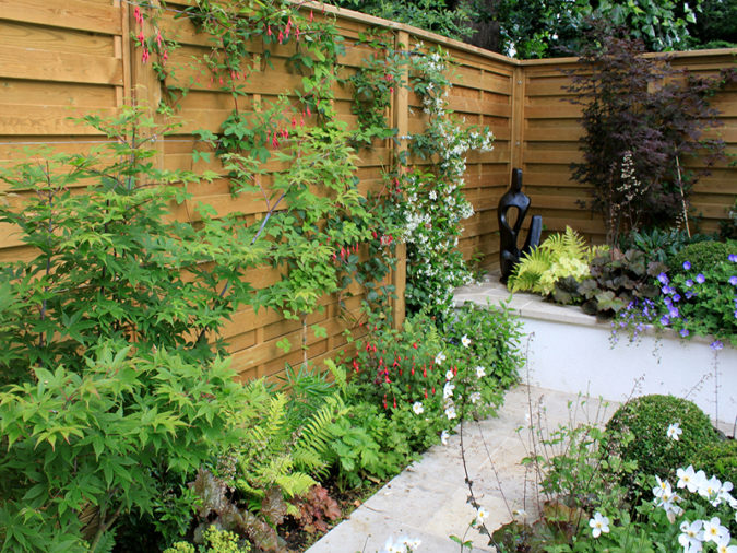 home-garden-green-fencing-675x506 Top 20 Garden Trends: Early Predictions to Adopt