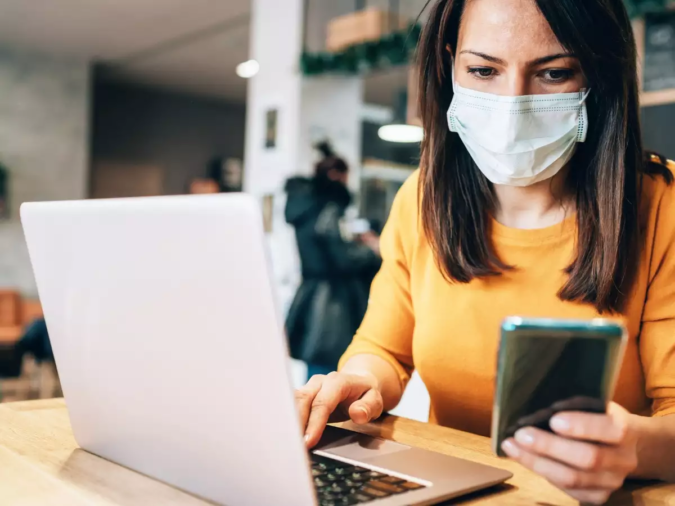 laptop-working-wearing-mask-675x506 Here's How The Covid-19 Pandemic Has Changed Wedding Planning