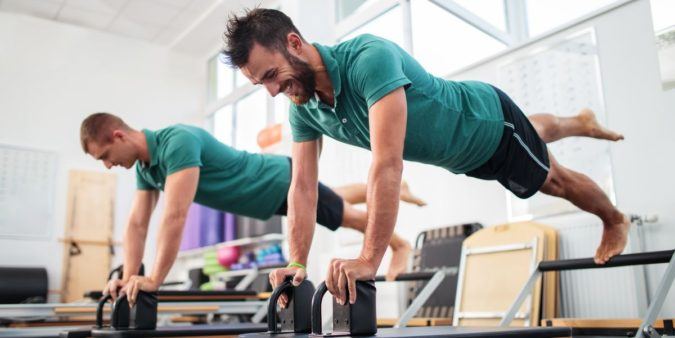 practicing-Pilates-675x338 10 Ways to Gain More Clients for Pilates Instructors