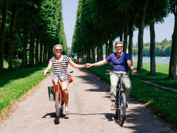 visiting-paris-riding-bikes-around-Versailles-675x506 7 Things Americans Should Know Before Visiting France