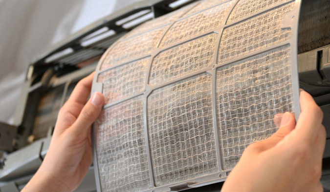 cleaning-aircon-filter-675x394 10 Ways to Keep Your Home Smelling Clean and Fresh