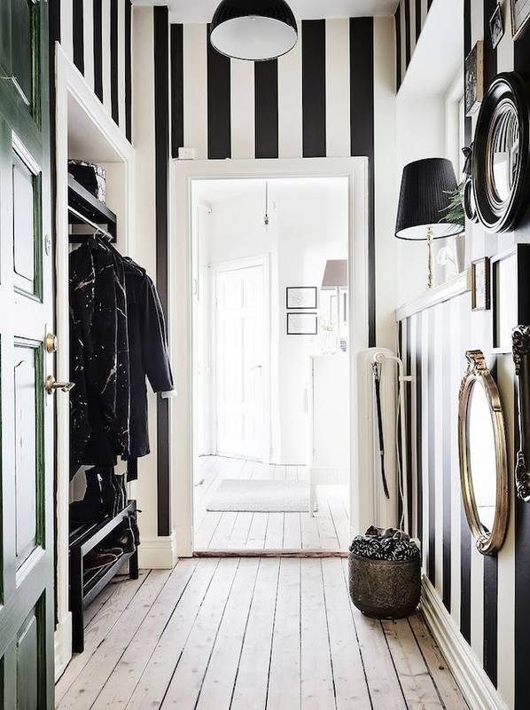 hallway-decor-stripped-walls Affordable Interior Design Tips to Make Your Home Look Luxurious
