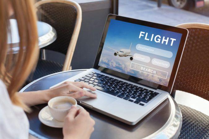 laptop-booking-flight-online-2-675x450 10 Tips to Get Best Flight Booking Deals