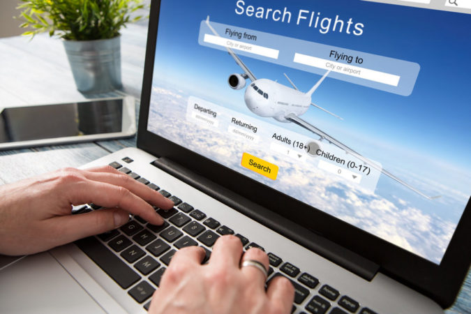 laptop-booking-flight-online-675x450 10 Tips to Get Best Flight Booking Deals