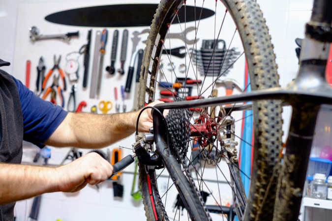 bicycle-repairing-2-675x450 How an Autistic Person Can Start His Own Business and Hire Others