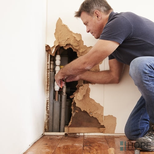 plumbing-homeowner-removing-drywall How Hard Is It to Add a New Bathroom to an Older Home?