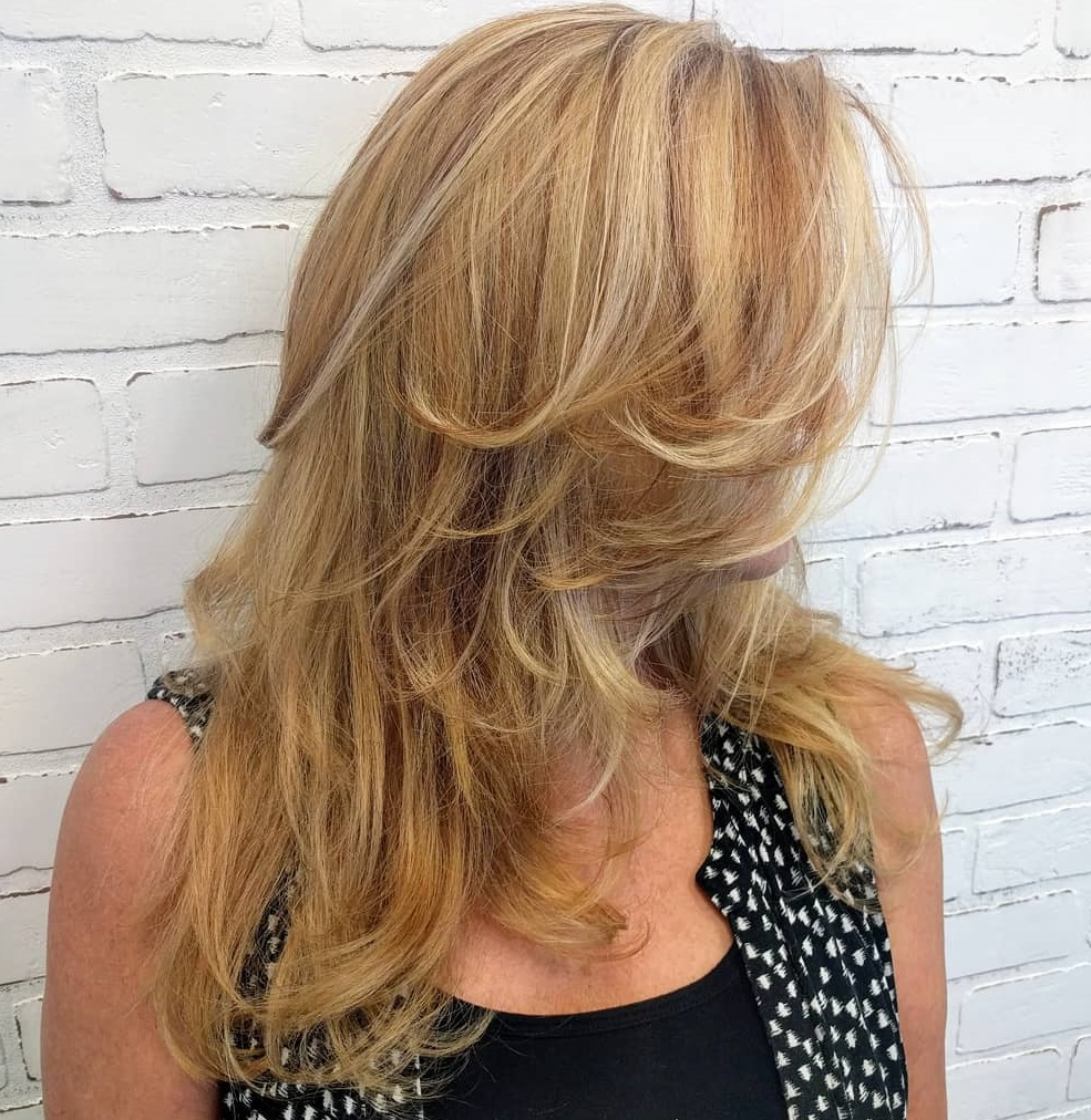 Long-hair-with-beachy-waves-and-layers. Best 12 Hairstyles for Women Over 60 to Look Younger