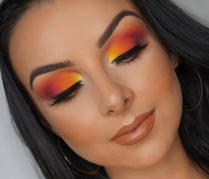 Sunset-eye-colorful-makeup.-675x579 Best 10 Colorful Face Makeup Looks to Try in 2021