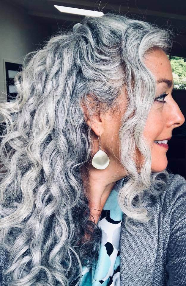 Thegray-salt-and-pepper-curls 15 Beautiful Gray Hairstyles that Suit All Women Over 50