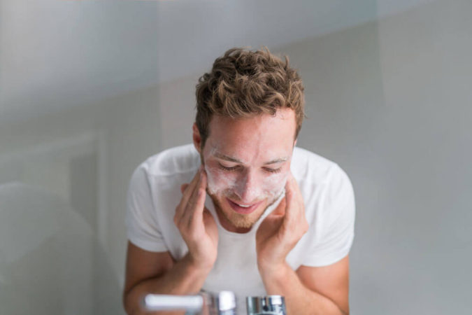 man-exfoliating-face-675x450 How to Look Your Best While Wearing a Mask – Tips for Men and Women
