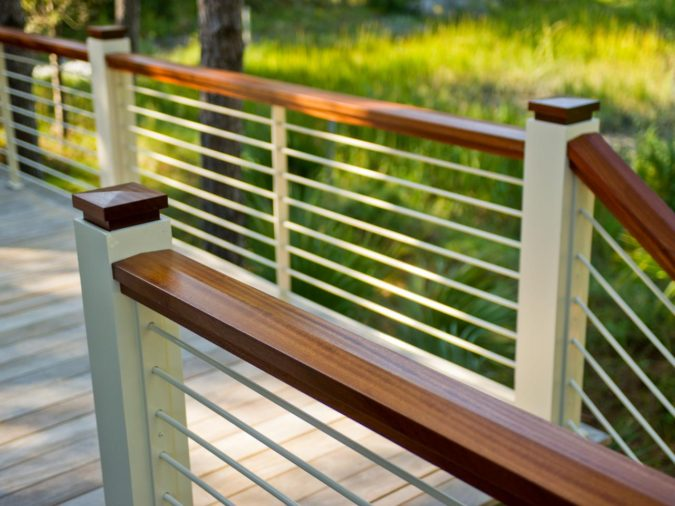 house-deck-wooden-railing-675x506 4 Simple Steps to Increase the Value of the House with Deck Railing Project Ideas