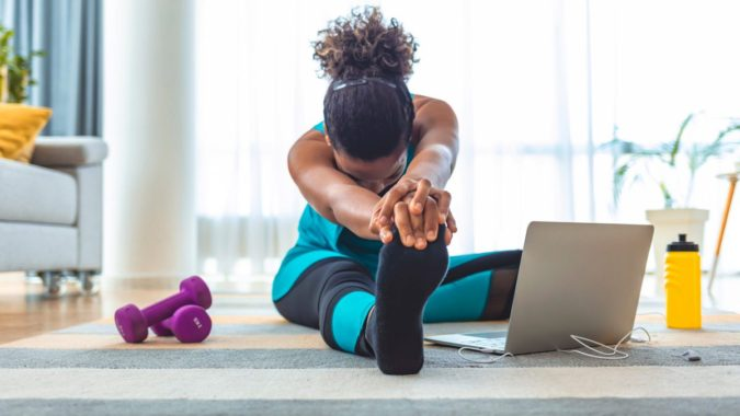 laptop-woman-exercising-675x380 7 Benefits of GetFit Fitness Mobile App for Your Health
