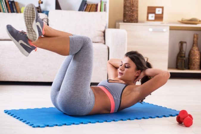 woman-exercising-fitness-2-675x451 7 Benefits of GetFit Fitness Mobile App for Your Health