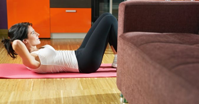 woman-exercising-fitness-3-675x354 7 Benefits of GetFit Fitness Mobile App for Your Health