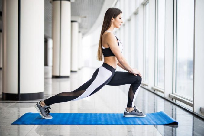 woman-exercising-fitness-4-675x450 7 Benefits of GetFit Fitness Mobile App for Your Health