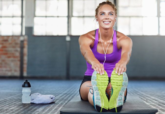 woman-exercising-fitness-5-675x468 7 Benefits of GetFit Fitness Mobile App for Your Health